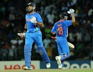 Indian cricketers Yuvraj Singh (L) and Virat Kohli (R) celebrate during the ICC Twenty20 Cricket World Cup's Super Eight match between India and Pakistan at the R. Premadasa International Cricket Stadium in Colombo. India crushed arch-rivals Pakistan and Australia put on another Shane Watson show as the race to the World Twenty20 semi-finals heated up on Sunday