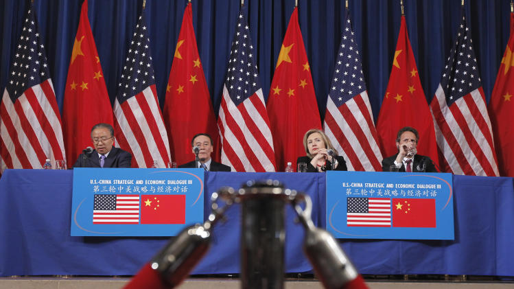 Chinese State Councilor Dai Bingguo, left, speaks as, from second from left, China's Vice Premier Wang Qishan, Secretary of State Hillary Rodham Clinton, and Treasury Secretary Timothy Geithner, listen at the end of their joint meeting of the US-China Strategic and Economic Dialogue (S&ED), Tuesday, May 10, 2011, at the Interior Department in Washington.  (AP Photo/Alex Brandon)