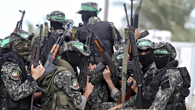 Hamas militants attend the funeral of Palestinian Jihad Al-Obeed, who was shot dead by Israeli troops on Friday, in Deirl al-Balah in the central Gaza Strip