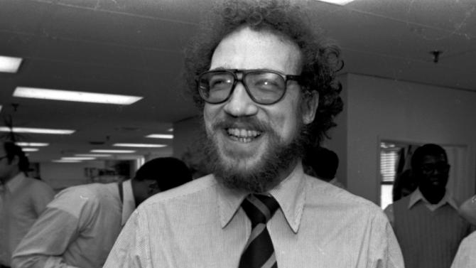 FILE - In an April 16, 1979 file photo, The Philadelphia Inquirer's Richard Ben Cramer celebrates with colleagues in the Inquirer city room after winning the Pulitzer Prize for his reporting in the Middle East. Cramer, whose narrative non-fiction spanned presidential politics and the game of baseball, died Monday, Jan. 7, 2013 at Johns Hopkins Hospital in Baltimore from complications of lung cancer, says his agent, Philippa Brophy. He was 62. (AP Photo/File)