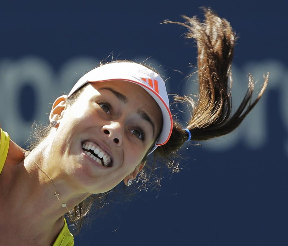 Serbia's Ana Ivanovic serves to Sweden's Sofia Arvidsson in the second round of play at the 2012 US Open tennis tournament,  Thursday, Aug. 30, 2012, in New York. (AP Photo/Mike Groll)