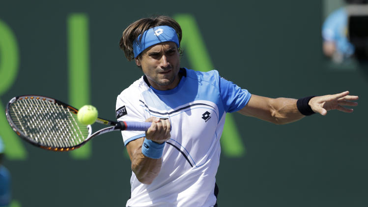 David Ferrer, of Spain, returns to Tommy Haas, of Germany, during a semifinal match at the Sony Open tennis tournament, in Key Biscayne, Fla., Friday, March 29, 2013. (AP Photo/Alan Diaz)