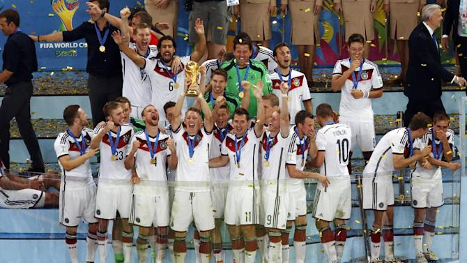 Germany team celebrate after winning the World Cup final soccer match between Germany and Argentina at the Maracana Stadium in Rio de Janeiro, Brazil, Sunday, July 13, 2014. Mario Goetze volleyed in the winning goal in extra time to give Germany its fourth World Cup title with a 1-0 victory over Argentina on Sunday
