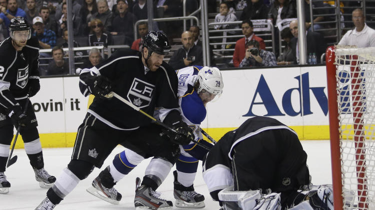 St. Louis Blues' T.J. Oshie, center, tries to score against Los Angeles Kings goalie Jonathan Quick, right, as he is defended by Los Angeles Kings' Rob Scuderi during the first period in Game 6 of a first-round NHL hockey Stanley Cup playoff series in Los Angeles, Friday, May 10, 2013. (AP Photo/Jae C. Hong)