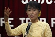 Myanmar opposition leader Aung San Suu Kyi speaks to the media during a press conference at the National League for Democracy Party headquarters in Yangon on July 3. Suu Kyi has brushed off orders from Myanmar&#39;s government to stop calling the country &quot;Burma&quot;, a name widely used by democracy campaigners to defy the former junta