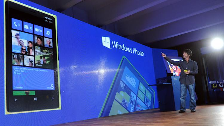 IMAGE DISTRIBUTED FOR NOKIA - Joe Belfiore, corporate vice president, Microsoft, shows how consumers can personalize their Windows Phone 8 experience on the Nokia Lumia 920 and Lumia 820 smartphones launched today at a press event in New York, Wednesday, Sept. 5, 2012. The Lumia 920 features a camera able to take in five times more light than competing smartphones for sharp pictures in low light without flash, and the phone comes with integrated wireless charging and a suite of location-based apps for personalized mapping and navigation.  (Photo by Diane Bondareff/Invision for Nokia/AP Images)