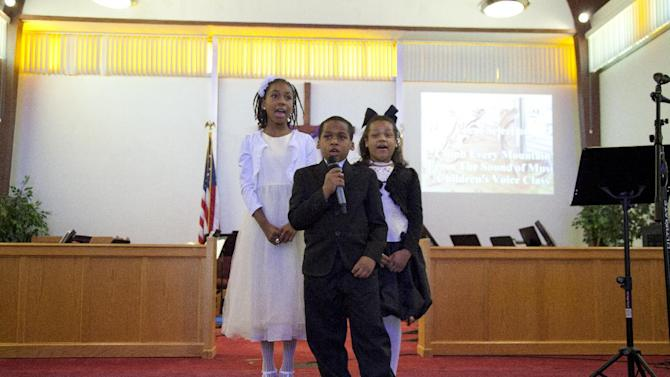 """Members of the children's voice class from left, Faith Harrell, George Hayson, and Sharolyn Hayson, sing """"Climb Every Mountain, from The Sound of Music, during the Alexandria School for the Performing Arts winter recital in the chapel of the Salvation Army, Sunday, March 11, 2012, in Alexandria, Va. A survey of Salvation Army youth programs in more than 80 cities shows more than eight in 10 programs saw increased demand from children and families in the past year as the nation's high jobless rate and cutbacks in government and private funding strained charities. The survey released to The Associated Press found 56 percent of the charity's youth programs _ including camps, preschools, daycare and after-school programs _ are operating at or beyond their capacity. (AP Photo/Carolyn Kaster)"""