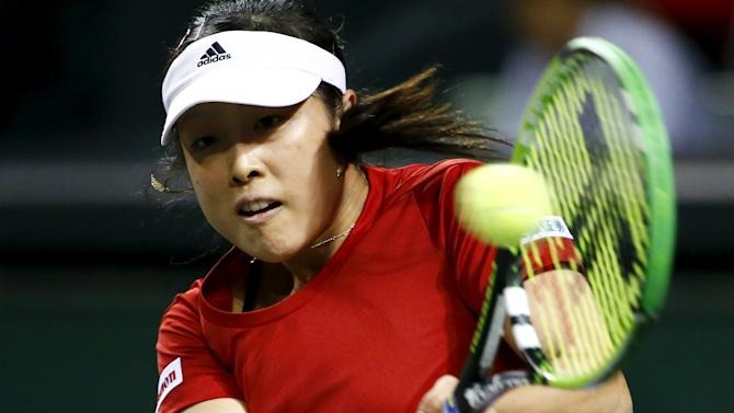 Morita of Japan returns a shot to Sasnovich of Belarus during their Fed Cup tennis match in Tokyo