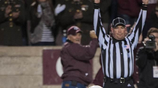 Texas A&M's Mike Evans reacts after making a touchdown catch against Missouri during the second quarter of an NCAA college football game on Saturday, Nov. 24, 2012, in College Station, Texas. (AP Photo/Dave Einsel)