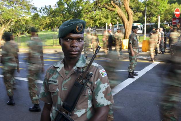 Members of the SANDF guard the route that a hearse carrying the coffin of former South African President Mandela will travel on, to the Union Buildings in Pretoria