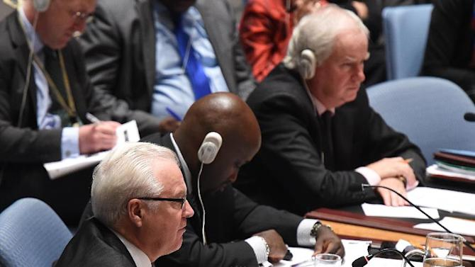 Russia's Ambassador to the UN Vitaly Churkin speaks during a meeting of the United Nations Security Council on September 19, 2014 in New York