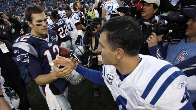 New England Patriots quarterback Tom Brady (12) shakes hands with Indianapolis Colts kicker Adam Vinatieri (4) after the Patriots' 31-24 win in NFL football game in Foxborough, Mass., Sunday, Dec. 4, 2011. (AP Photo/Charles Krupa)