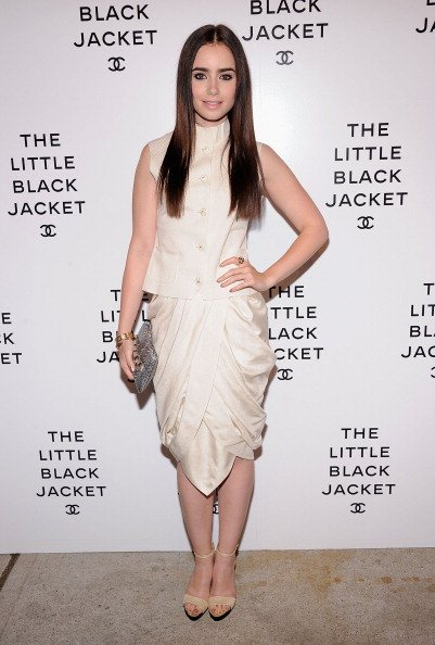 Lily Collins attends Chanel's:The Little Black Jacket Event wearing Chanel pre fall, 2012. The Swiss Institute on June 6, 2012 in New York City. (Photo by Jamie McCarthy/Getty Images)