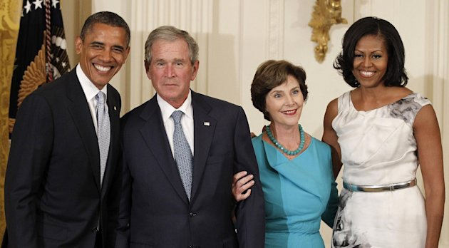 From left, President Barack Obama, former President George W. Bush, former first lay Laura Bush and first lady Michelle Obama, pose in the East Room of the White House in Washington, Thursday, May 31, 2012, during a ceremony to unveil the Bush portraits. (AP Photo/Pablo Martinez Monsivais)
