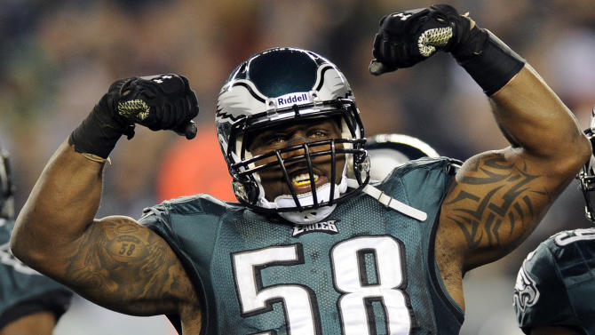 Philadelphia Eagles defensive end Trent Cole reacts after tackling Carolina Panthers running back Jonathan Stewart in the first half of an NFL football game, Monday, Nov. 26, 2012, in Philadelphia. (AP Photo/Michael Perez)