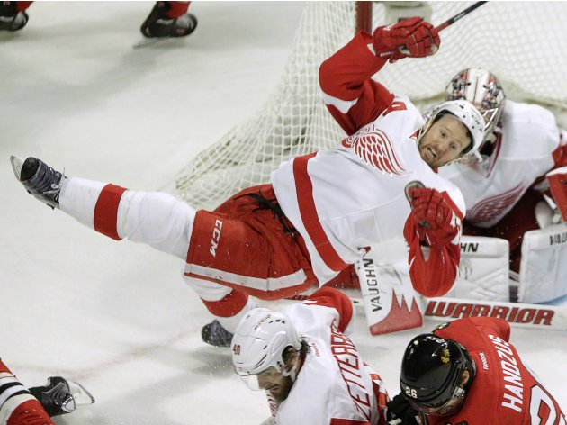 Detroit Red Wings defenseman Kronwall falls during Game 5 of their NHL Western Conference semifinal playoff hockey game against the Chicago Blackhawks in Chicago