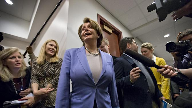 "House Minority Leader Nancy Pelosi, D-Calif., the top Democrat in the Republican-controlled House of Representatives, speaks to reporters on the ""fiscal cliff"" bill passed by the Senate Monday night that's waiting for the House vote at the Capitol in Washington, Tuesday, Jan. 1, 2013. Democrats were meeting with Vice President Joe Biden who has been shuttling between the White House and Capitol Hill to help negotiate a legislative path to avert the across-the-board tax increases and sweeping spending cuts that could damage the economy. (AP Photo/J. Scott Applewhite)"