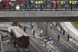 Emergency personnel work at the site of a train accident …