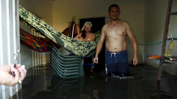 People are seen in flooded house in Guasdualito, in state of Apure, Venezuela