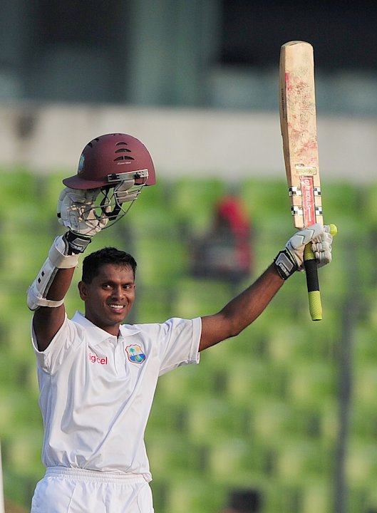 West Indies cricketer Shivnarine Chanderpaul acknowledges the crowd after scoring a century during the first day of the first Test match between Bangladesh and West Indies at the Sher-e-Bangla Nationa