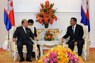 Cambodian Prime Minister Hun Sen (R) talks to North Korea&#39;s Foreign Minister Pak Ui-Chun (L) during a meeting in Phnom Penh. North Korea told Cambodia it is ready to rejoin stalled six-party denuclearisation talks, according to local sources, but there was no mention of whether it would agree to any pre-conditions first