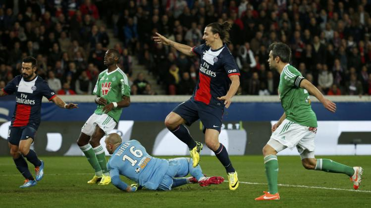 Paris St Germain's Ibrahimovic scores against St Etienne during their French Ligue 1 soccer match at the Parc des Princes Stadium in Paris