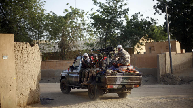 Tuareg Malian soldiers under the command of Colonel El-Hadj Ag Gamou patrol the streets of Gao, northern Mali, Saturday Feb. 16 2013. After 10 months of forced exile to Niger, Gamou returned to help French and African forces flush jihadists from the region. (AP Photo/Jerome Delay)
