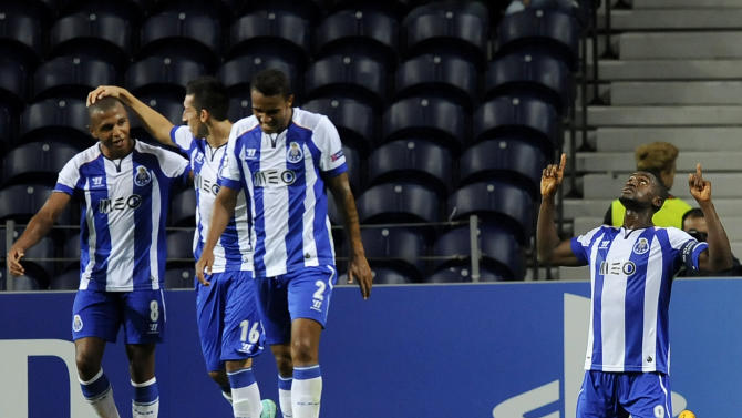Porto's Jackson Martinez, right, from Colombia celebrates his team third goal with Yacine Brahimi from Algeria, Hector Herrera from Mexico, and Danilo Silva from Brazil, from left to right, during the Champions League Group H soccer match between FC Porto and FC BATE Borisov at Dragao Stadium in Porto, Portugal, Wednesday Sept. 17, 2014. (AP Photo/Paulo Duarte)