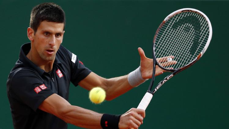 Djokovic of Serbia returns the ball to Garcia-Lopez of Spain during their quarter-final match at the Monte Carlo Masters in Monaco