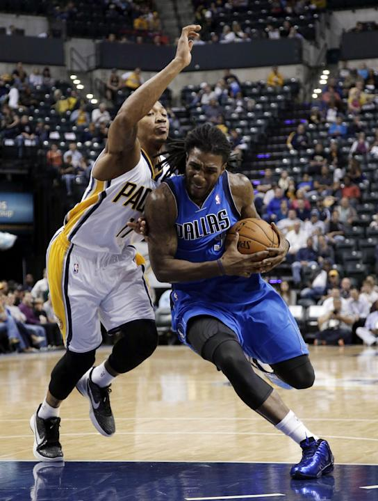 Dallas Mavericks forward Jae Crowder, right, drives around Indiana Pacers guard Orlando Johnson during the first half of an NBA preseason basketball game in Indianapolis, Wednesday, Oct. 16, 2013. The