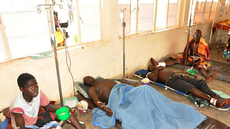 Patients injured by a suicide bombing are seen at the 44 Military Hospital in Kaduna