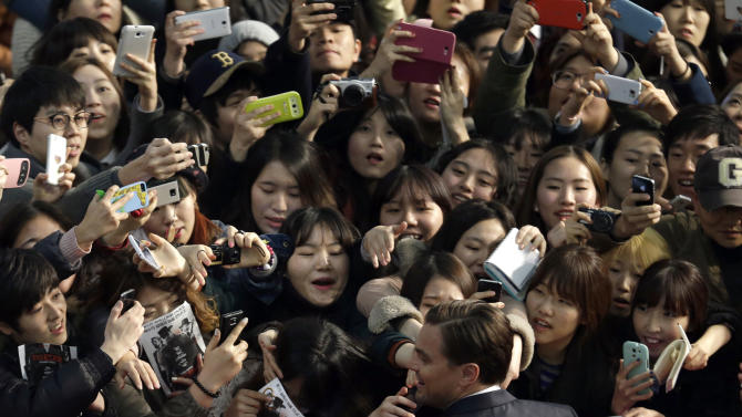 "Actor Leonardo DiCaprio is mobbed by fans during the premiere of his new film ""Django Unchained"" in Seoul, South Korea, Thursday, March 7, 2013. DiCaprio is here to promote the film which is to be released in South Korea on March 21. (AP Photo/Lee Jin-man)"