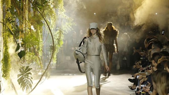 Models present creations by Italian designer Giambattista Valli as part of his Spring/Summer 2014 women's ready-to-wear collection for fashion house Moncler Gamme Rouge during Paris Fashion