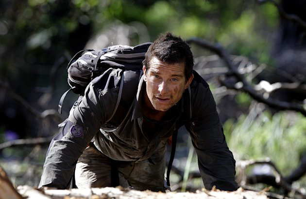 In this May 25, 2010 publicity image released by Discovery Channel, adventurer Bear Grylls is shown at Mount Borradaile in Australia&#39;s north-western Arnhemland during filming of the series, &quot;Man vs. Wild.&quot; NBC said Monday, Oct. 8, 2012, that it is making a competition series with Grylls. The NBC series, Get Out Alive, is planned for airing next summer. In it, Grylls will guide two teams in adventures. He says competitors will learn survival skills and teamwork but will have to suffer some pain before being rewarded in the end. (AP Photo/Discovery Channel, Luis Enrique Ascui)