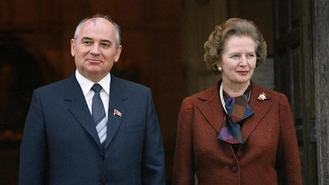 """FILE - In this Dec. 15, 1984 file photo, Mikhail S. Gorbachev poses with Britain's Prime Minister Margaret Thatcher in London. Ex-spokesman Tim Bell says that Thatcher has died. She was 87. Bell said the woman known to friends and foes as """"the Iron Lady"""" passed away Monday morning, April 8, 2013. (AP Photo/File)"""