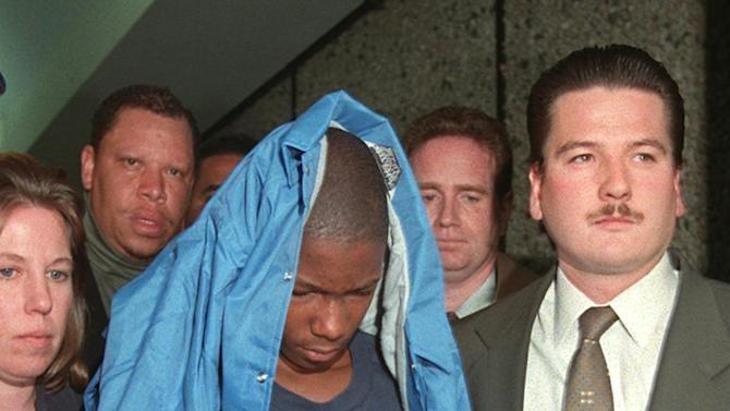 FILE - In this June 3, 1997 file photo, Malcolm Shabazz, 12, is led from family court in Yonkers, N.Y., in connection with the death of his grandmother, Betty Shabazz, the widow of political activist Malcolm X. U.S. officials say Malcolm Shabazz was killed Thursday, May 10, 2013 in Mexico City. (AP Photo/Kathy Willens, File)