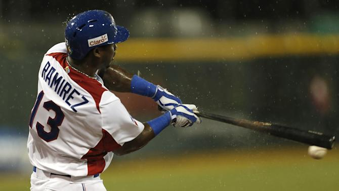 Dominican Republic's Hanley Ramirez singles during the first inning of the World Baseball Classic first round game against Venezuela in San Juan, Puerto Rico, Thursday, March 7, 2013. (AP Photo/Andres Leighton)