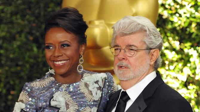 """FILE - In this Nov. 16, 2013 file photo, filmmaker George Lucas and his wife, Chicago native Mellody Hobson, are seen on the red carpet at the 2013 Governors Awards in Los Angeles. Chicago Mayor Rahm Emanuel is trying to persuade the """"Star Wars"""" creator to put his planned museum of art and movie memorabilia in Chicago and is offering up a slice of real estate along the Lake Michigan shorefront where it would be located. A competing bid from San Francisco seems a more natural fit: it's Lucas' hometown, it's a premier center of technology and innovation and it's closer to the nation's movie-making heartland. (Photo by John Shearer/Invision/AP)"""