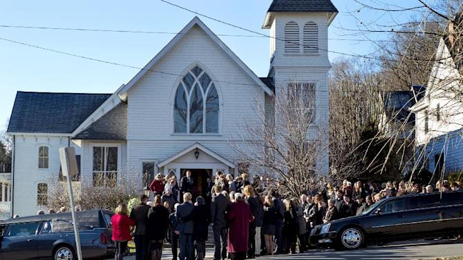 Mourners gather at the funeral for teacher Anne Marie Murphy at the St. Mary Of The Assumption Church in Katonah, N.Y. Thursday, Dec. 20, 2012. Murphy was killed when Adam Lanza, walked into Sandy Hook Elementary School in Newtown, Conn., Dec. 14, and opened fire, killing 26, including 20 children, before killing himself.  (AP Photo/Craig Ruttle)
