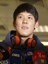 South Korean swimmer Park Tae-Hwan addresses the media as he arrives at Heathrow airport, west of London, on July 21, six days ahead of the start of the London 2012 Olympic Games