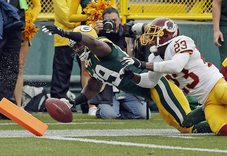 Rodgers has career day, Pack wallop Redskins 38-20
