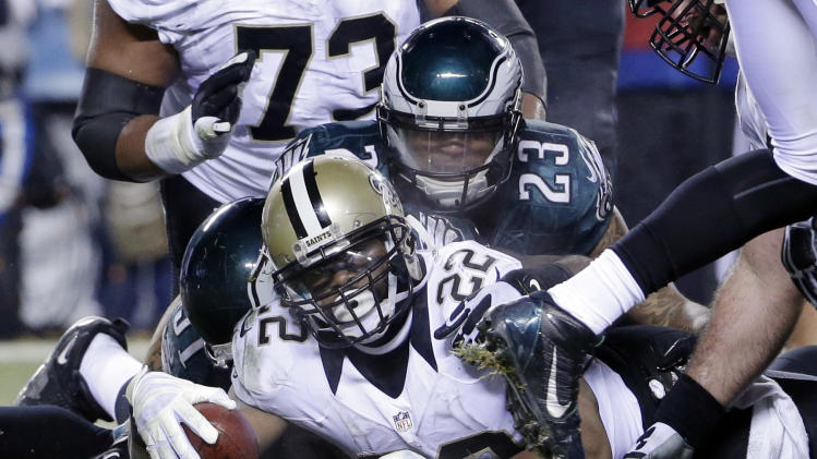 New Orleans Saints' Mark Ingram (22) scores a touchdown as Philadelphia Eagles' Patrick Chung (23) defends during the second half of an NFL wild-card playoff football game, Saturday, Jan. 4, 2014, in Philadelphia. (AP Photo/Matt Rourke)