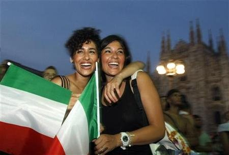 Fans celebrate after Balotelli scored against Germany during their Euro 2012 semi-final soccer match in Milan