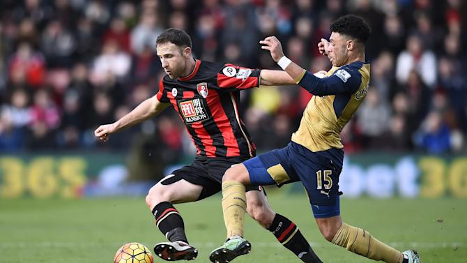 Bournemouth's Marc Pugh in action with Arsenal's Alex Oxlade Chamberlain