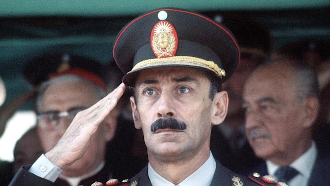 "FILE - In this March 24, 1977 file photo, Gen. Jorge Rafael Videla is seen commemorating the first anniversary of the military coup in Asuncion, Argentina. The former Argentine dictator died of natural causes Friday, May 17, 2013, while serving life sentences at the  Marcos Paz prison for crimes against humanity. Videla took power in a 1976 coup and led a military junta that killed thousands of his fellow citizens in a dirty war to eliminate ""subversives."" He was 87. (AP Photo/Eduardo Di Baia, File)"