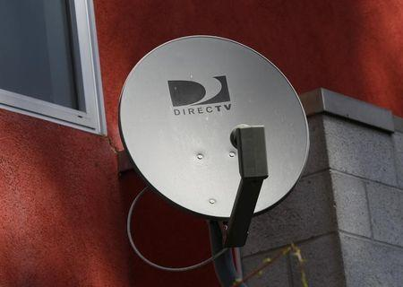 A DirecTV satellite dishe is seen on an apartment wall in Los Angeles