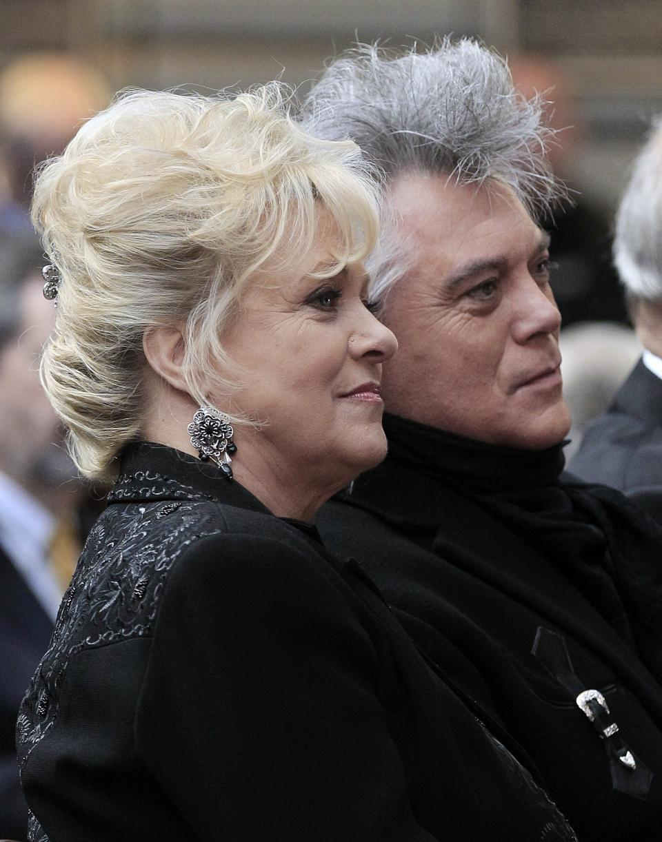 "Connie Smith and her husband, singer Marty Stuart, listen during the announcement on Tuesday, March 6, 2012, that Smith will be inducted into the Country Music Hall of Fame in Nashville, Tenn. Smith, Garth Brooks, and Hargus ""Pig"" Robbins will become the newest members. (AP Photo/Mark Humphrey)"