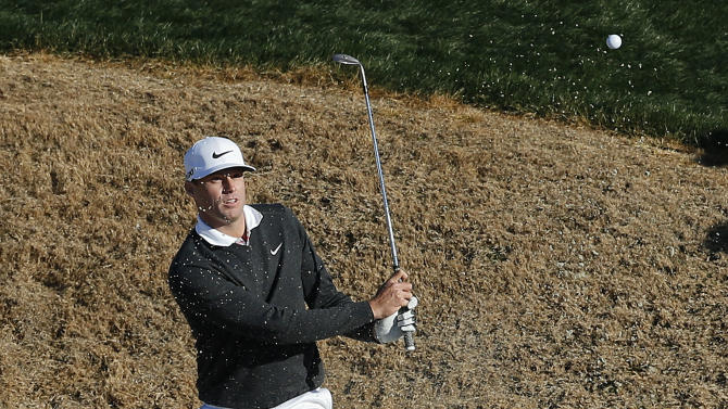 Nick Watney hits out of the bunker on the third green in the second round of play against Steve Stricker during the Match Play Championship golf tournament, Friday, Feb. 22, 2013, in Marana, Ariz. Stricker won 1 up in 21 holes. (AP Photo/Ross D. Franklin)