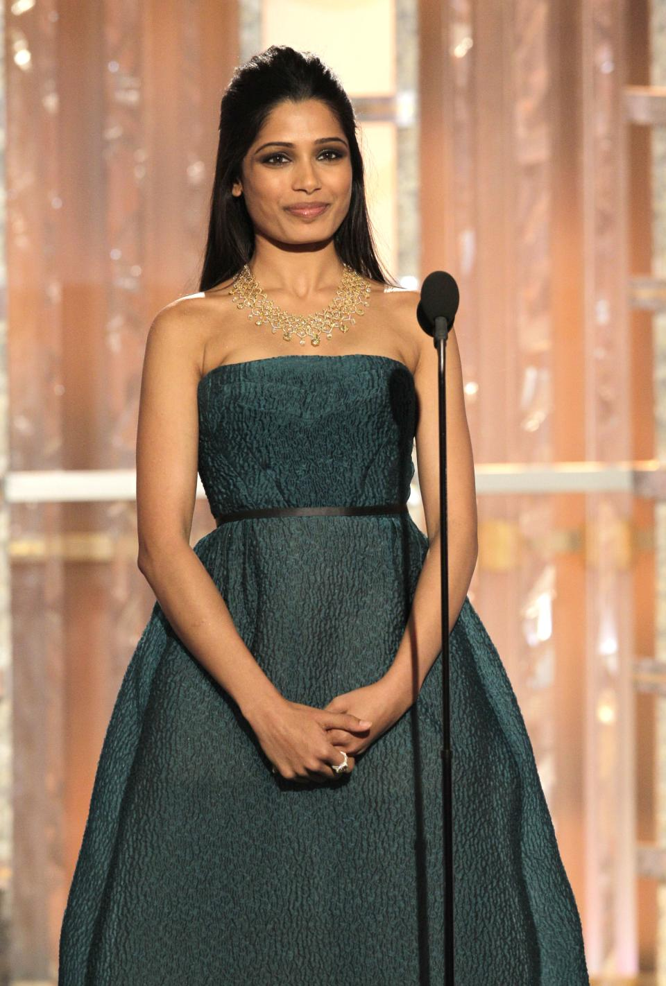 In this image released by NBC, presenter Freida Pinto appears during the 69th Annual Golden Globe Awards, Sunday, Jan. 15, 2012 in Los Angeles. (AP Photo/NBC, Paul Drinkwater)