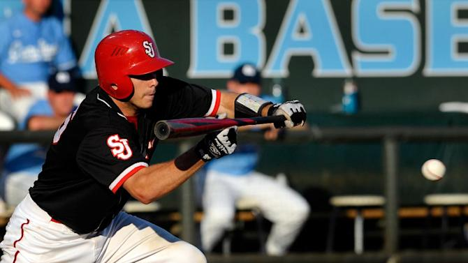 St. John's Dan Roland (6) bunts during the third inning of an NCAA regional tournament college baseball game against North Carolina, Sunday, June 3, 2012, in Chapel Hill, N.C. St. John's won 9-5. (AP Photo/Sara D. Davis)